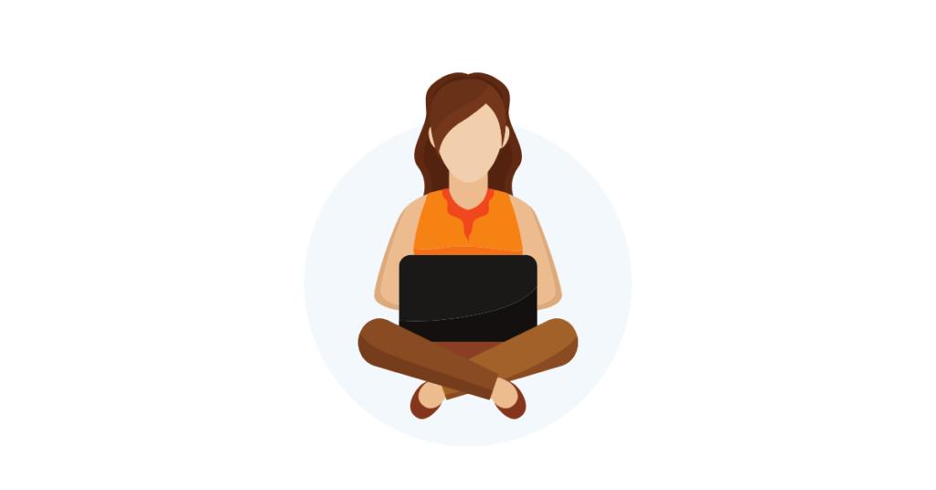 Woman sitting cross legged with computer